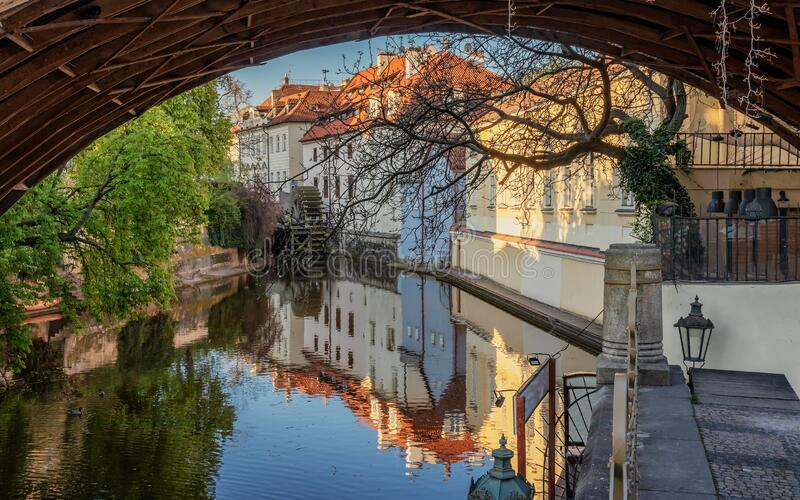 View under the arch of the Charles Bridge on the Certovka water wheel. Prague. royalty free stock images