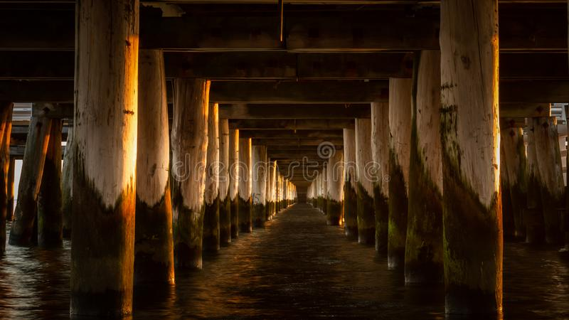 View under the Sopot pier on Baltic Sea in Poland at the sunrise. royalty free stock image