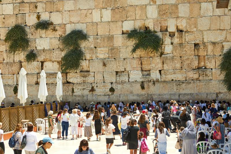 View of unknowns people praying front the Western wall in the old city of Jerusalem royalty free stock photo