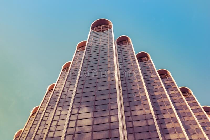 View up a skyscraper with colorful sky royalty free stock images