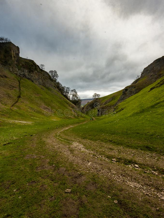 The view up to Peveril Castle, Castleton in the Peak District on a winters day stock image