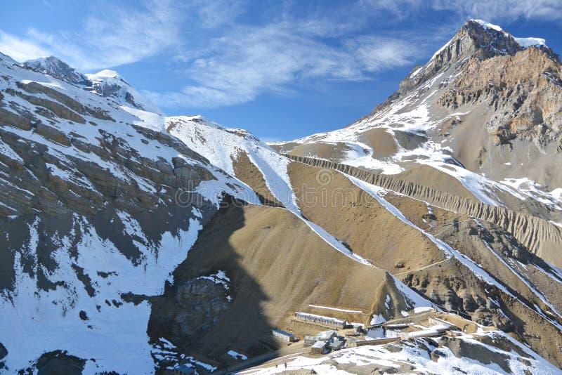 View of upper camp and Thorung La pass. Annapurna trek, Himalaya mountains, Nepal. November 2014 stock photo