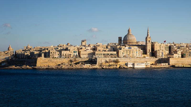 View of Valletta as seen from Tigne point in Sliema, late afternoon warm light royalty free stock images
