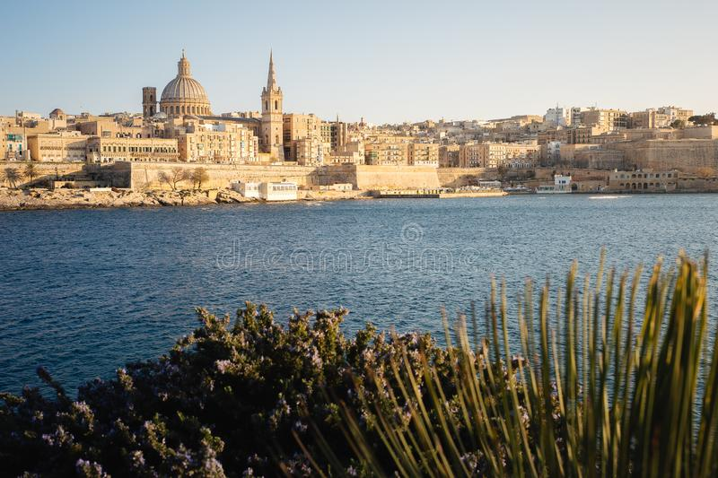 View of Valletta as seen from Tigne point in Sliema, late afternoon warm light stock photo