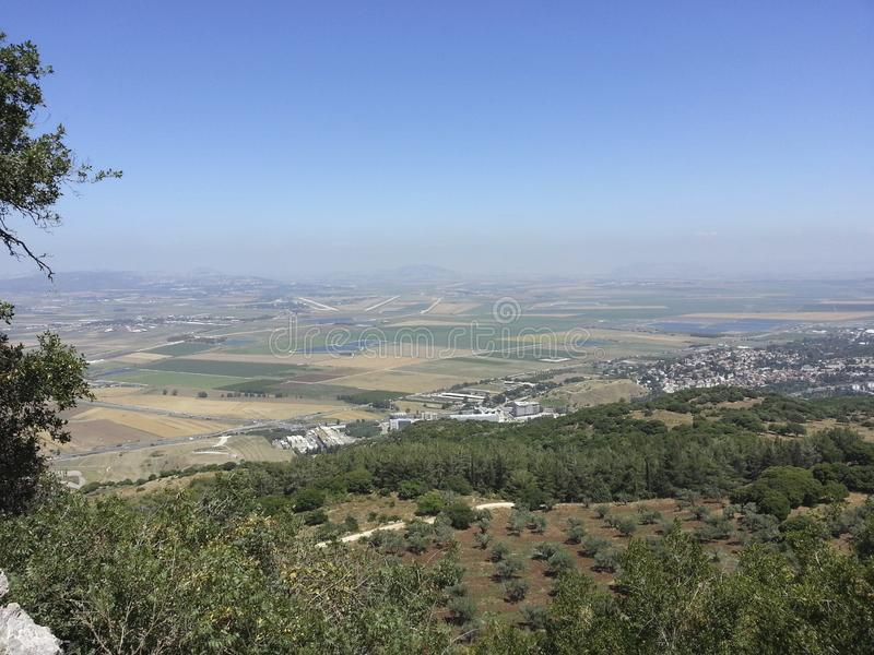 View of the valley of Armageddon or Megiddo. Mt. Carmel view of Meggido or the Jezreel valley or Valley of Armageddon. It's also a beautiful view of a farming royalty free stock images
