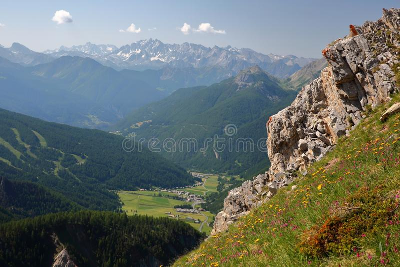 View of the valley of Arvieux with Brunissard and Arvieux villages, with pine tree forests and mountain range covered with snow. Queyras Regional Natural Park stock photo