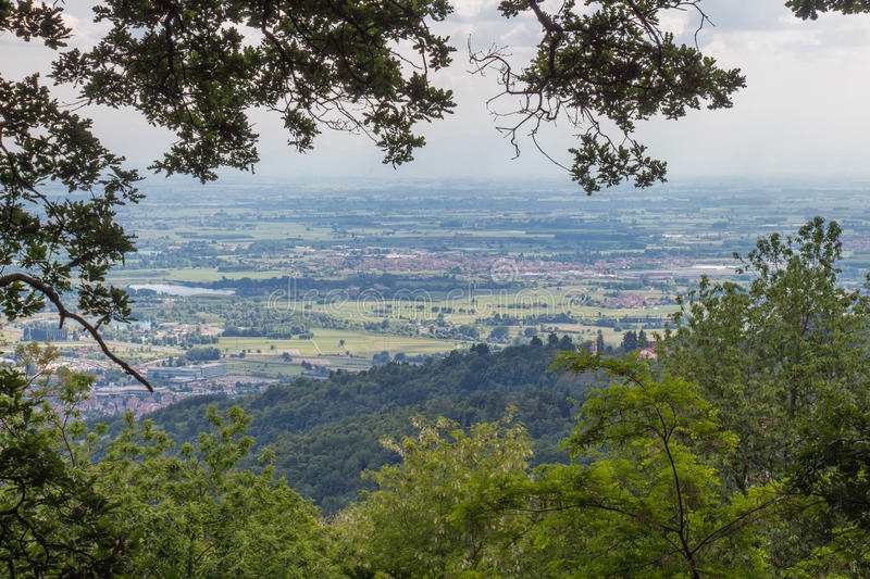 View of valley through green trees. Remembrance park. Piedmont Italy. stock photography