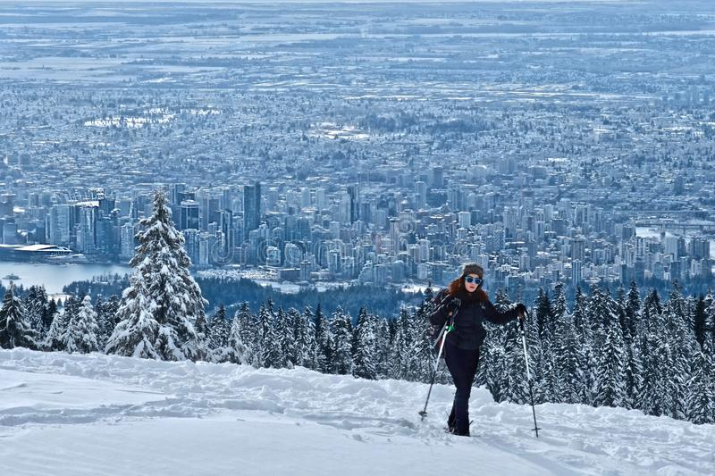 Woman hiking snowshoeing near North Vancouver on Cypress Mountain ski resort in winter. royalty free stock photos
