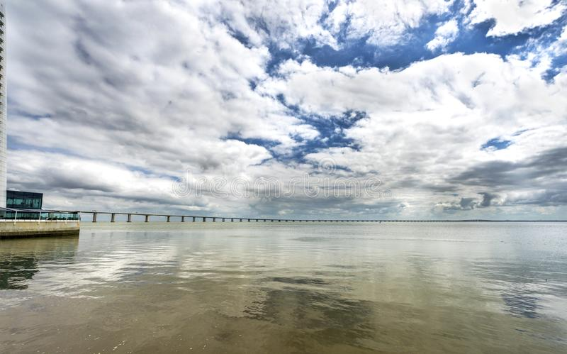 View on Vasco da Gama bridge on a cloudy day. Lisboa, Portugal royalty free stock images