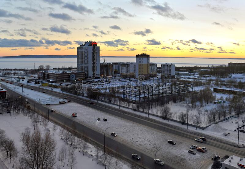 View of the Vega shopping and hotel complex and new residential buildings in the city of Togliatti against a sunset sky. Togliatti, Samara region, Russia stock photography
