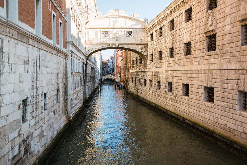 View of Venice towards the canal and gondolas. Charming morning view of the main canal in venice with parked gondolas royalty free stock photo