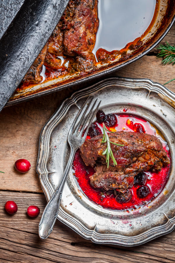 View of venison with cranberry sauce and rosemary royalty free stock photography
