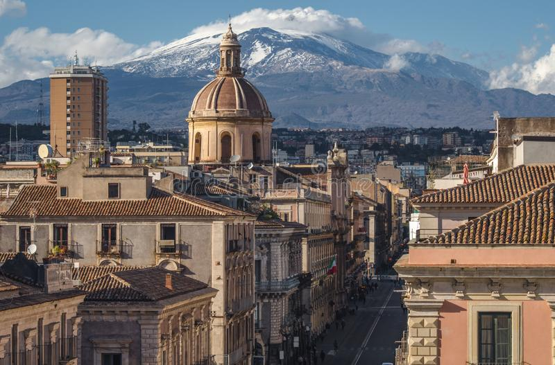 View on via Etnea in Catania. Dome of Catania and the main street with the background of volcano Etna stock photography