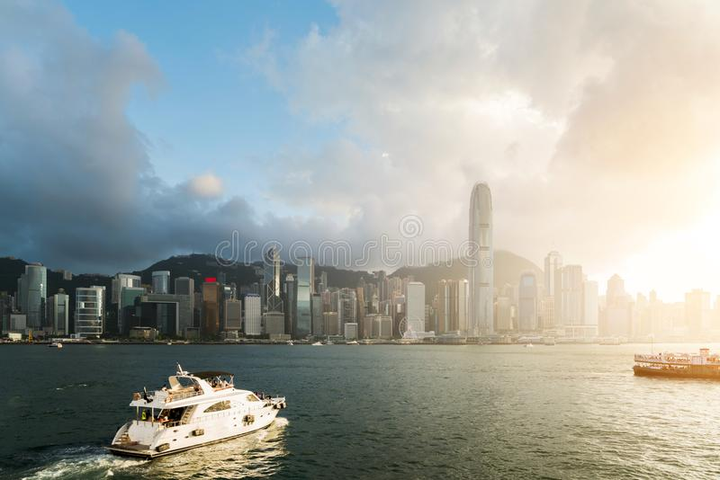 View of Victoria Harbour with Hong Kong skyscraper office buildings and cruise ship at sunset time in Hong Kong. Asia. stock photos