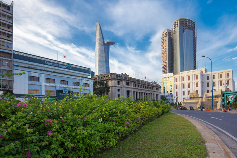 View of VietNam bank at downtown center with buildings across riverside Saigon river Ho Chi Minh City. HO CHI MINH CITY, VIETNAM - JULY 21, 2015 : Downtown royalty free stock image