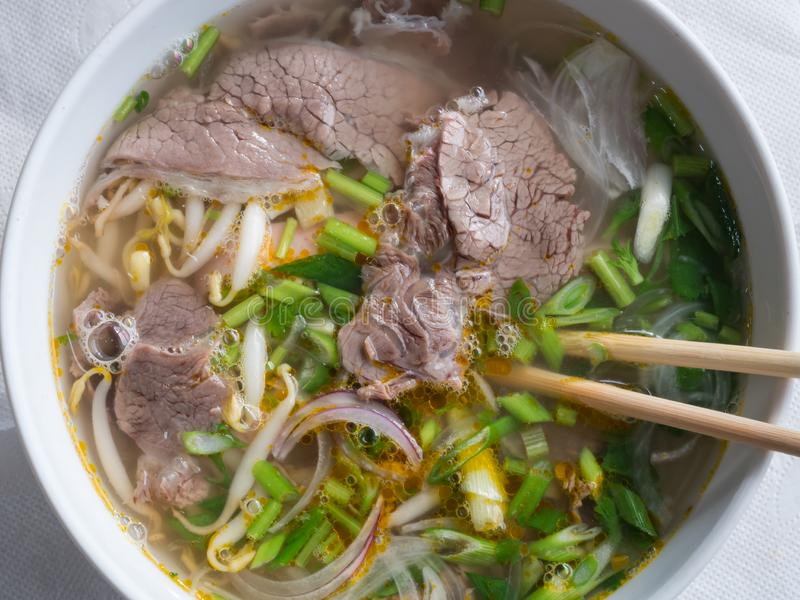 View of the Vietnamese pho-bo soup in white plate royalty free stock photo