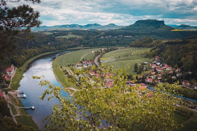 View from viewpoint of Bastei National Park to the town city and the river Elbe. Saxon Switzerland, Germany. View from viewpoint of Bastei National Park to the royalty free stock photo