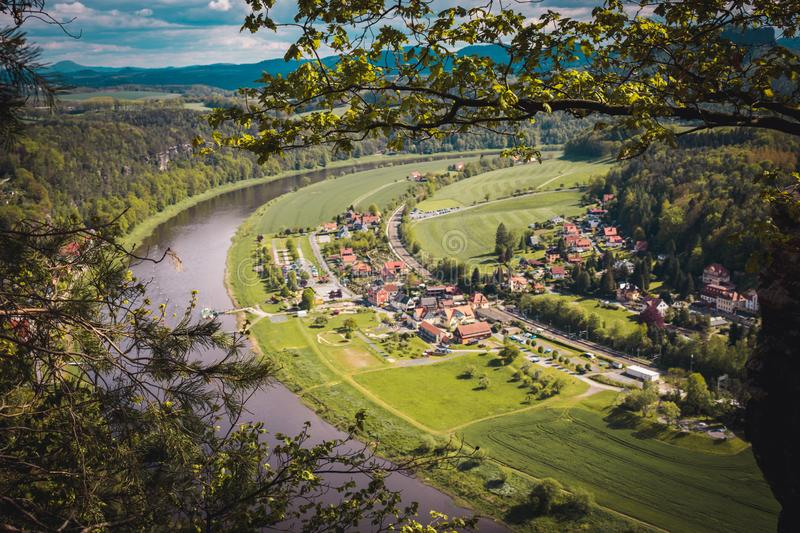 View from viewpoint of Bastei National Park to the town city and the river Elbe. Saxon Switzerland, Germany. View from viewpoint of Bastei National Park to the royalty free stock photography