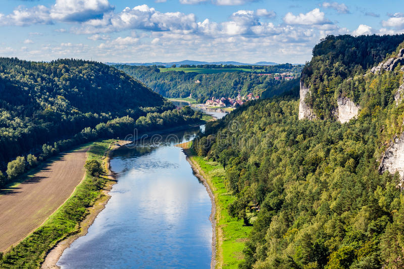 View from viewpoint of Bastei in Saxon Switzerland Germany to the town city and the river Elbe on a sunny day in autumn.  stock images