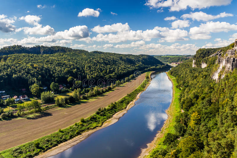 View from viewpoint of Bastei in Saxon Switzerland Germany to the town city and the river Elbe on a sunny day in autumn.  royalty free stock image