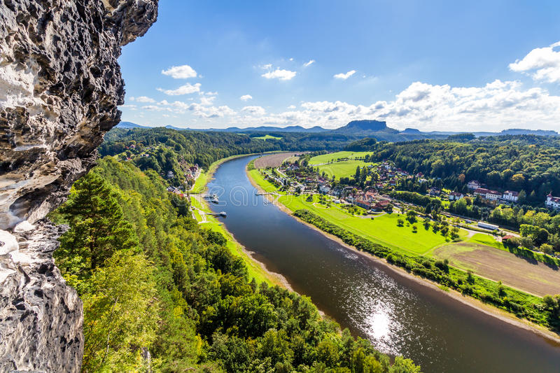 View from viewpoint of Bastei in Saxon Switzerland Germany to the town city and the river Elbe on a sunny day in autumn.  royalty free stock photo
