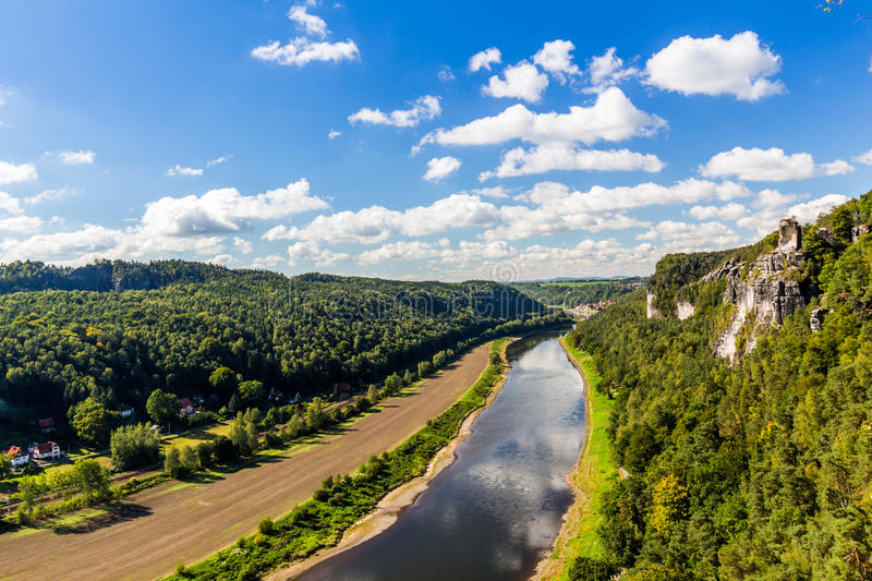View from viewpoint of Bastei in Saxon Switzerland Germany to the town city and the river Elbe on a sunny day in autumn.  stock image