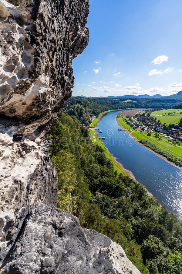 View from viewpoint of Bastei in Saxon Switzerland Germany to the town city and the river Elbe on a sunny day in autumn.  royalty free stock images