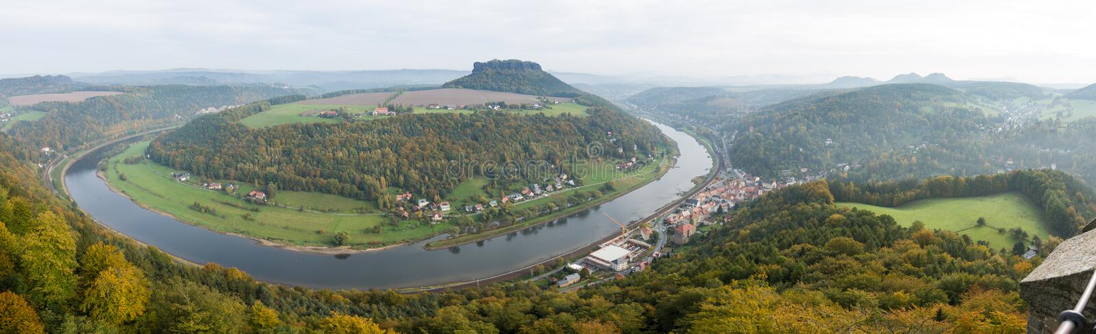 View from viewpoint of Bastei in Saxon Switzerland Germany to the town city and the river Elbe on a sunny day in autumn. View from viewpoint of Bastei in Saxon royalty free stock image