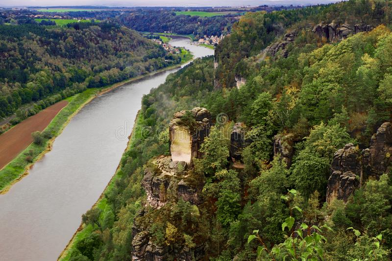 View from viewpoint of Bastei in Saxon Switzerland Germany to the town city and the river Elbe.  royalty free stock image