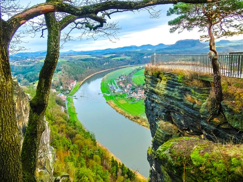 View from viewpoint of Bastei in Saxon Switzerland Germany to the town Wehlen and the river Elbe. On a day in winter stock photos