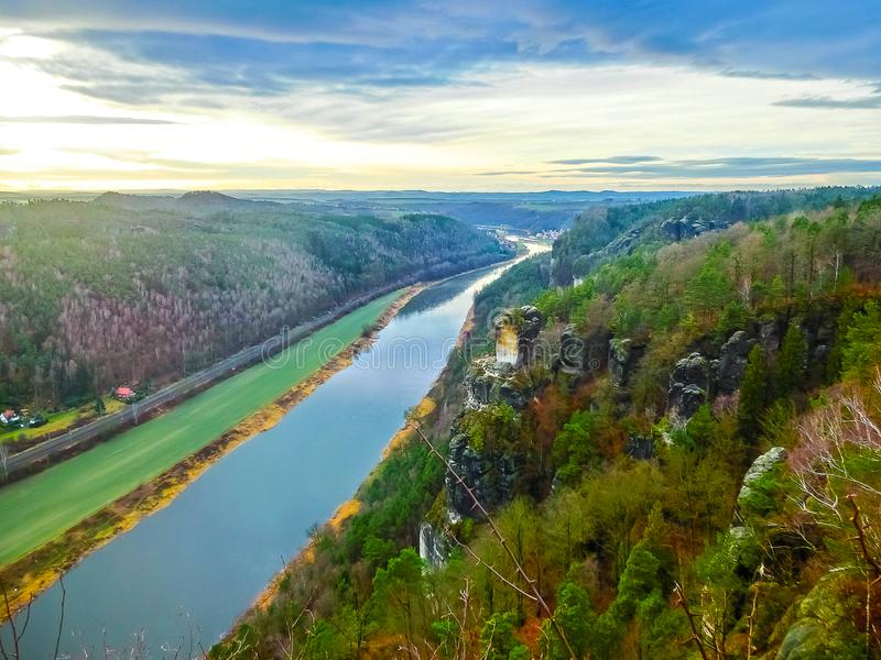 View from viewpoint of Bastei in Saxon Switzerland Germany to the town Wehlen and the river Elbe. On a day in winter stock image
