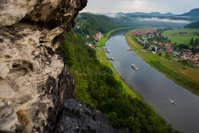 View from viewpoint of Bastei, to Elbe river and Kurort Rathen, National park Saxon Switzerland, Germany. Mist over the river Elbe stock photography