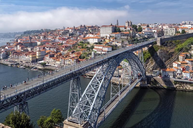 Ribeira Quarter and beyond, Vila Nova de Gaia, Portugal. A view from Vila Nova de Gaia looking across and above the Dom Luis 1 Bridge and River Douro towards royalty free stock photo