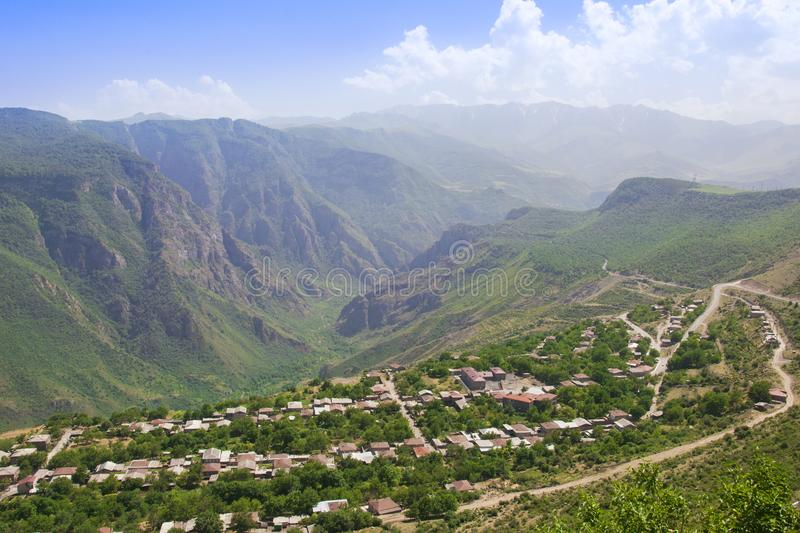 A view of the village of Alidzor, the mountains and the gorge. The blue summer sky. Beautiful scenery, Armenia royalty free stock photography