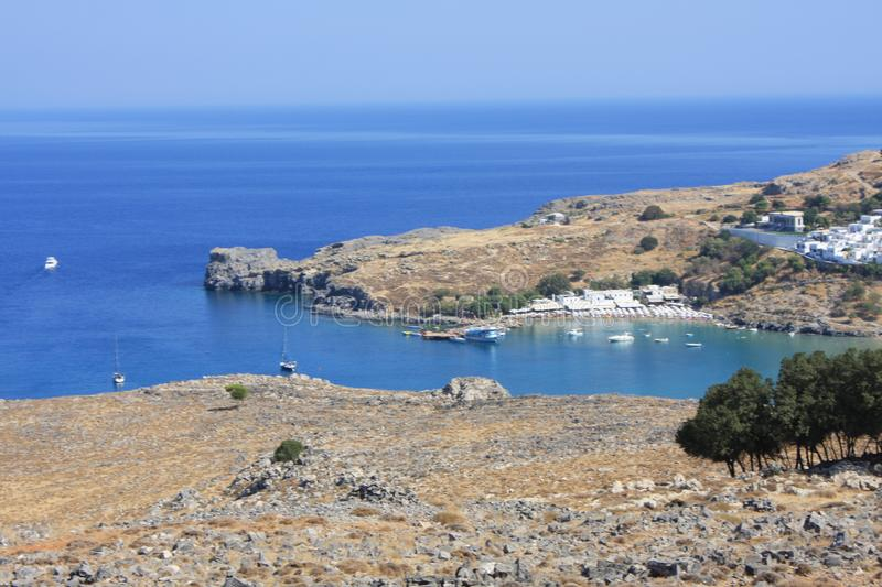 View of village, bay and Acropolis of Lindos Rhodes, Greece.  stock photo