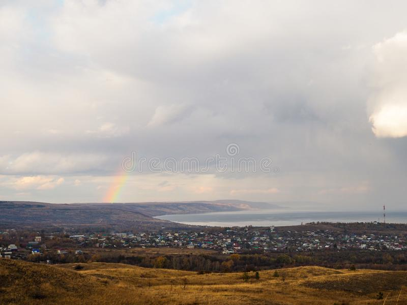 View of the village on a cloudy autumn day. rainbow after the rain.  stock image