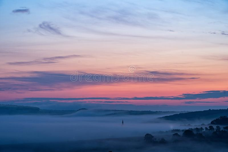 South moravian landscape with low clouds during a sunrise. stock photos