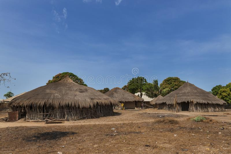 View of the village of Eticoga in the island of Orango with traditional huts. Orango Island, Guinea-Bissau - February 3, 2018: View of the village of Eticoga in royalty free stock images