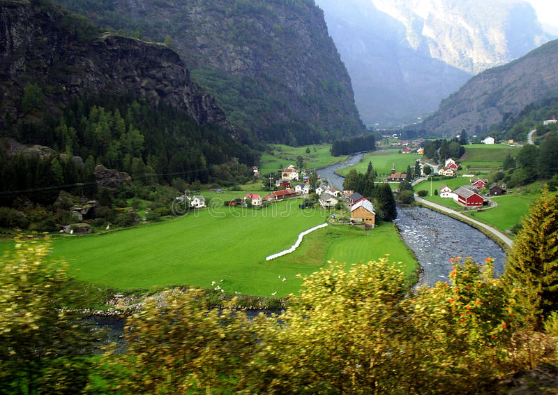 The view on a village from a Flåmsbana railway. The Flam Line is a 20.2-kilometer (12.6 miles) long railway line between Myrdal and Flåm in Aurland, Norway stock images