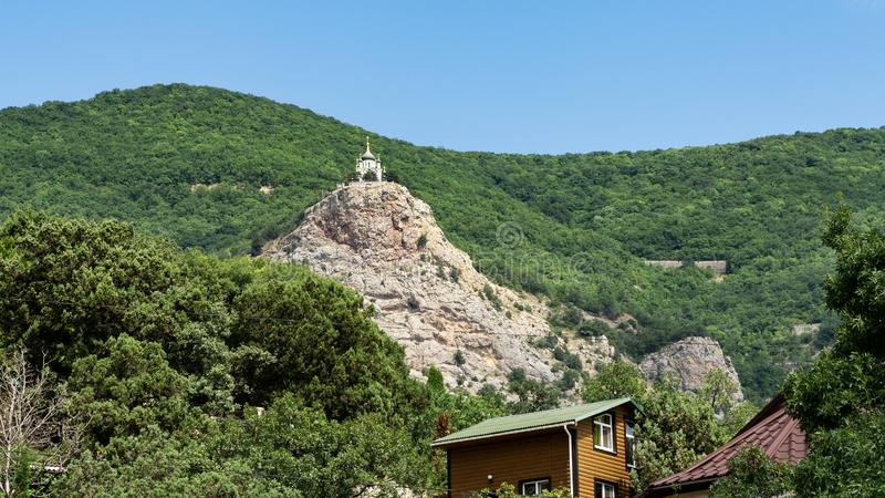 View from the village of foros on the Church of the resurrection against a green forest royalty free stock photography