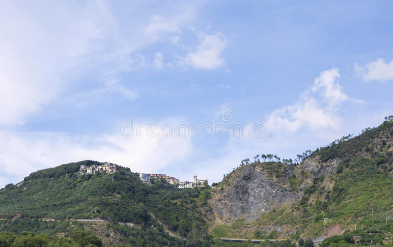 View of a village high up in the hilly Ligurian mountains, Italy. View of a village high up in the hilly Ligurian mountains. Pine trees on the crests. Cinque royalty free stock image