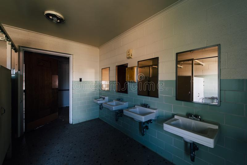 Vintage Bathroom with Sinks & Mirrors - Abandoned Sweet Springs - West Virginia. A view of a vintage bathroom with sinks and mirrors ine at the abandoned Sweet royalty free stock photography