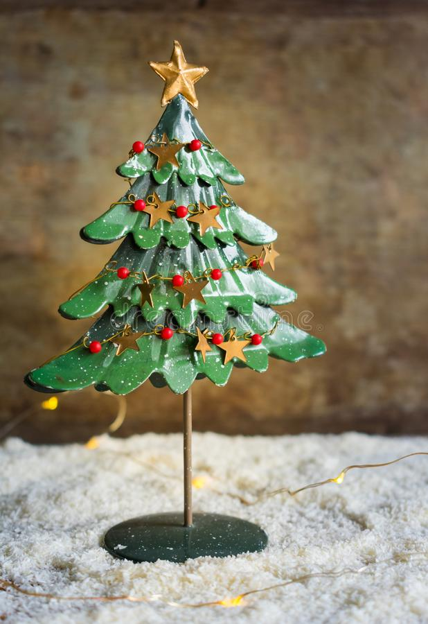View of a vintage Christmas tree decoration with wooden background stock photos
