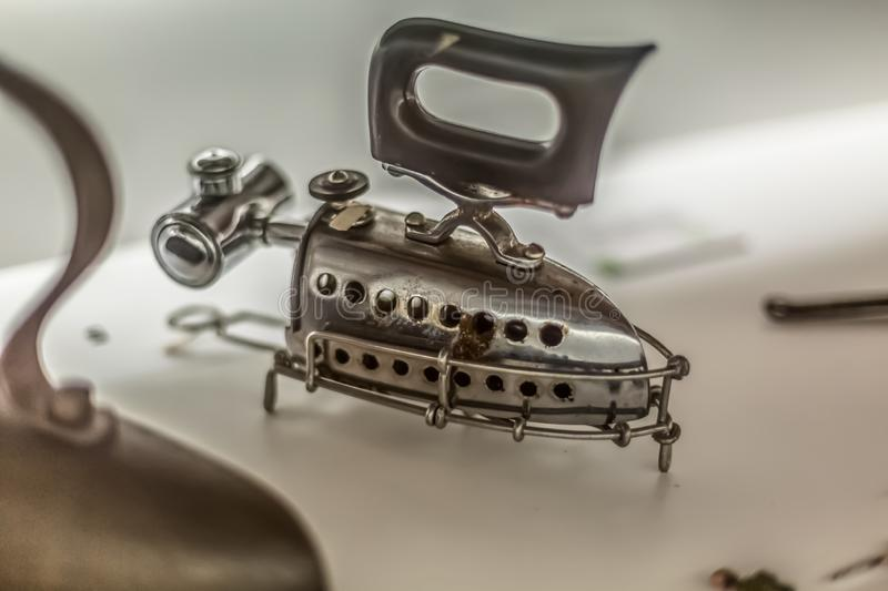 View of a vintage clothes iron, on display at an antique exhibition stock photos