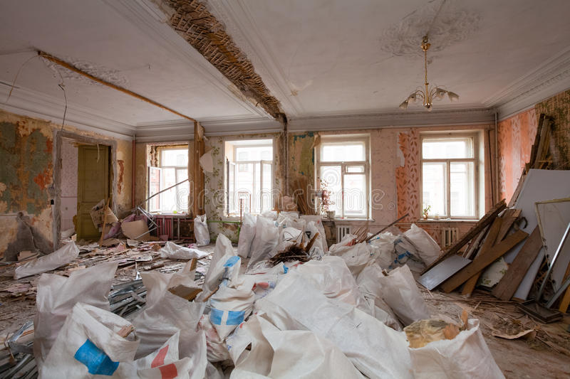 View of the vintage room with fretwork on the ceiling of the apartment and retro chandelier during under renovation, remodeling an. D construction. The process stock photography