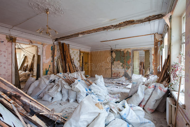 View of the vintage room with fretwork on the ceiling of the apartment and retro chandelier during under renovation, remodeling. And construction.nThe process royalty free stock photos