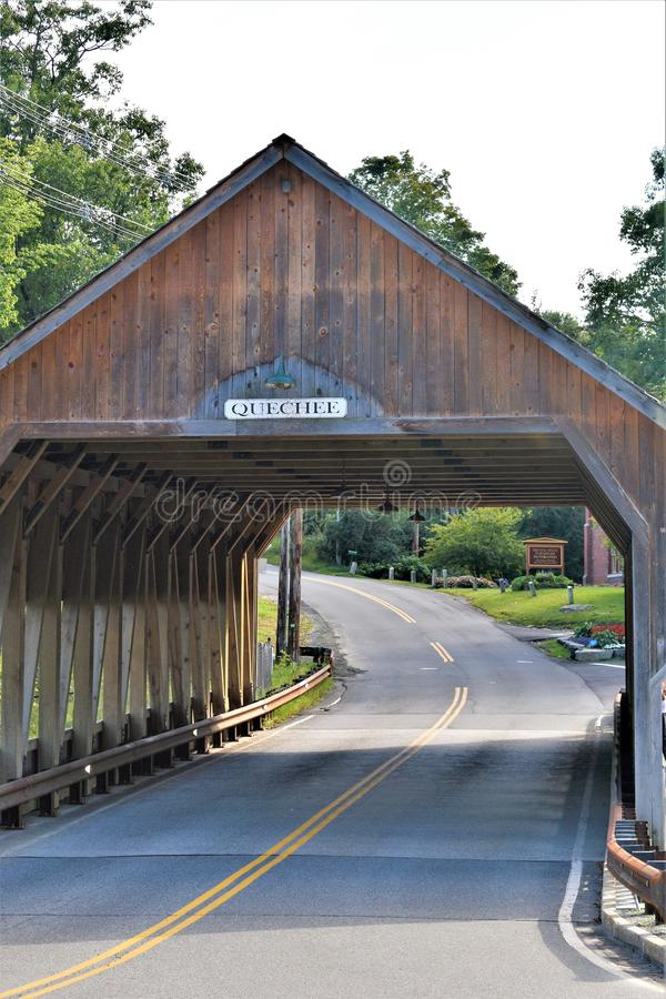 Quechee Covered Bridge, Quechee Village, Town of Hartford, Windsor County, Vermont, United States. View of the vintage wooden 2-lane covered bridge showing stock photo