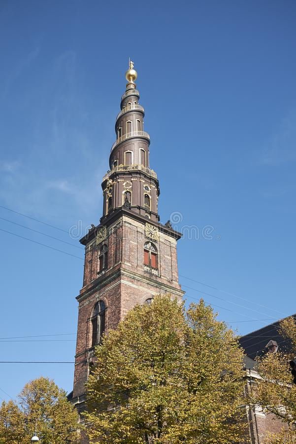 View of Vor Frelsers kirke spire. Copenhagen, Denmark - October 10, 2018 : View of Vor Frelsers kirke spire, our saviour church stock photography