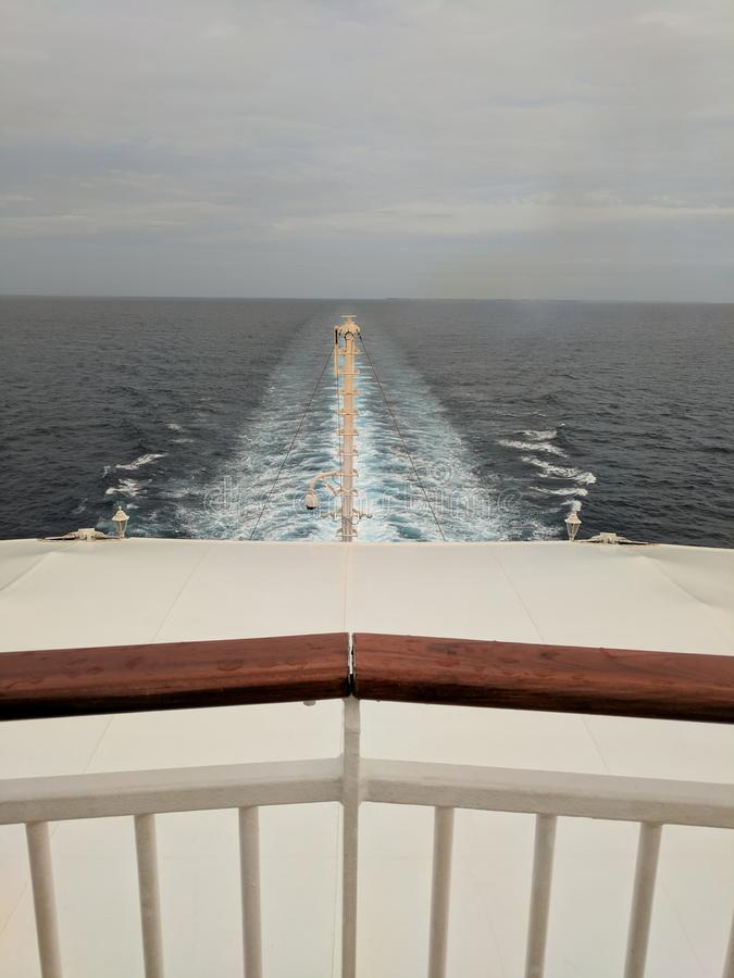 View from back of a cruise ship, overcast sky. View of the wake from the back of a cruise ship, with an overcast sky royalty free stock photos