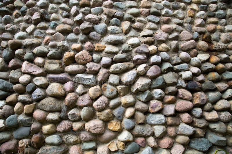 View of a wall of stones of irregular shapes, Backgrounds textures for graphic design. Wallpaper royalty free stock photo